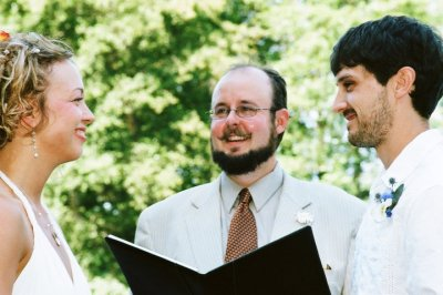 Reverend Erik performs a wedding ceremony outside.
