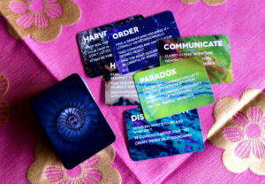 Several cards from The Sovereign Oracle deck